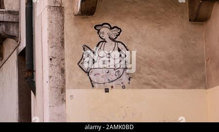 anti-consumption graffiti in Venice, Italy - Stock Photo