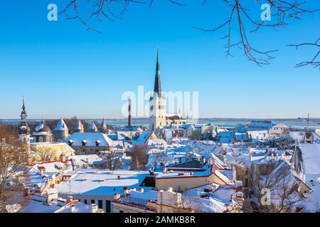 View to snow covered roofs of old town. Tallinn, Estonia - Stock Photo
