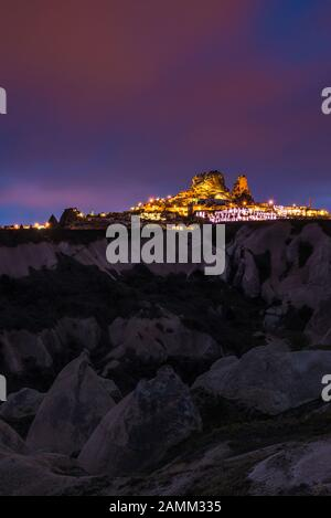 Goreme ancient city and a castle of Uchisar from a mountains after twilight, Cappadocia in Central Anatolia, Turkey