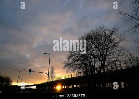 Evening mood at the slip road to the motorway A9 Munich - Nuremberg ('Tatzelwurm') near Freimann. [automated translation] - Stock Photo