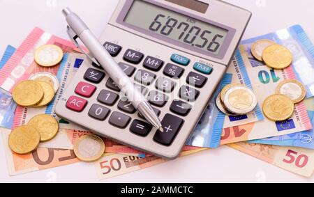 Euro cash with calculator [automated translation] - Stock Photo
