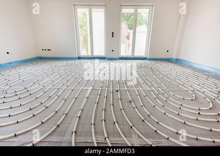 House construction with interior finishing of the underfloor heating and sanitary [automated translation] - Stock Photo