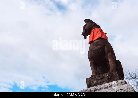 KYOTO, JAPAN-NOV 28:Stone sculpture of fox symbol statue at fushimi inari taisha shrine on November 28,2016. Fushimi inari taisha shrine is one of att - Stock Photo