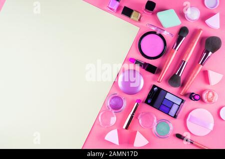 Make up accessories on pink. Flat lay - Stock Photo