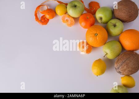Oranges, halved mandarins and apples. - Stock Photo