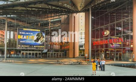 group of asian tourists posing in front of spielbank berlin, berlin casino - Stock Photo