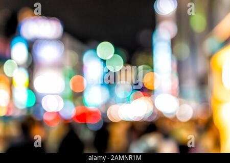Tokyo, Japan Shinjuku district at night with abstract blurry blurred bokeh background of lights on street urban nightlife shallow depth of field - Stock Photo