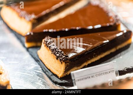 Crostata chocolate pastry tart pie dessert closeup in store window display in gourmet bakery Italian cafe with sign in Florence, Italy market - Stock Photo
