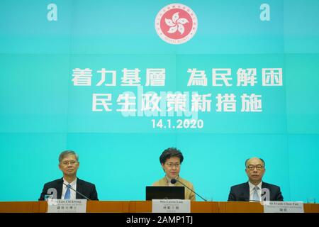 (200114) -- HONG KONG, Jan. 14, 2020 (Xinhua) -- Chief Executive of China's Hong Kong Special Administrative Region (HKSAR) Carrie Lam (C) attends a press conference in south China's Hong Kong, Jan. 14, 2020. Chief Executive of China's Hong Kong Special Administrative Region (HKSAR) Carrie Lam on Tuesday unveiled 10 new livelihood initiatives to benefit over a million grassroots and underprivileged locals. TO GO WITH 'HKSAR gov't unveils 10 livelihood initiatives to benefit over a mln grassroots' (Xinhua/Lui Siu Wai)