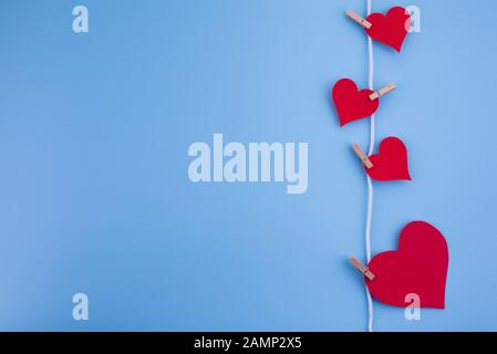 Valentine's day abstract background with paper cut decoration, flat layout - Stock Photo