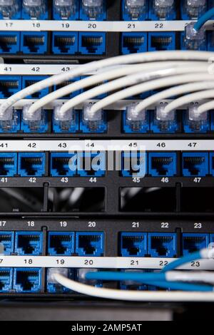 Close up shot of router cables in a data centre cabinet. Stock Photo