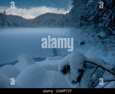 Snow covered Eibsee and Zugspitze in perfect light - Stock Photo