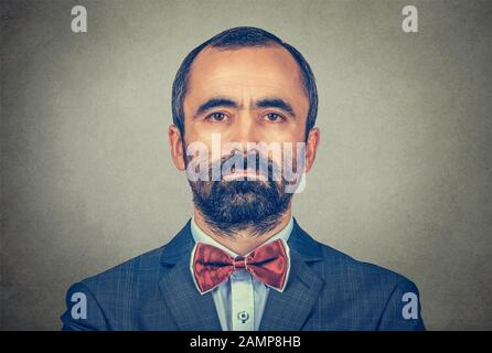 portrait of handsome hipster mature businessman with beard looking at you with serious and confident face expression. Mixed race bearded model isolate - Stock Photo