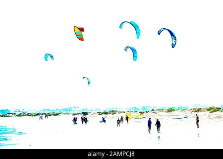 Kitesurfer with colourful sails on the beach, Santa Maria, Sal Island, Cape Verde - Stock Photo