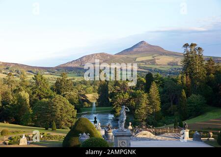 Sugarloaf Mountain in County Wicklow, Ireland seen from the gardens of Powerscourt House. - Stock Photo