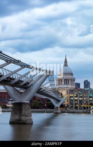 Millennium Bridge over River Thames with dome of St. Paul's Cathedral beyond, London, England, UK