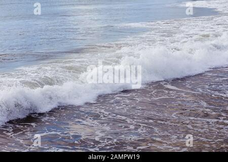 Waves Rolling In on a Sandy Beach in Santa Cruz, Callifornia - Stock Photo