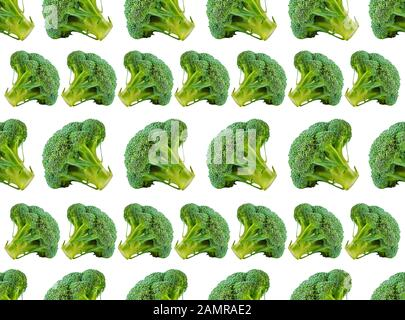 Broccoli pattern isolated on a white background. Various multiple parts of broccoli flower. Top view. - Stock Photo
