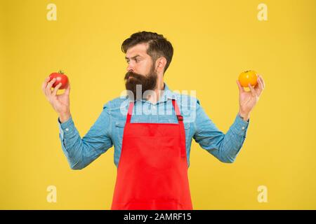 Selling homegrown ripe vegetables. Organic crops. Tomato diet. Salesman with tomatoes. Bearded man hold tomato in hands. Tomato salsa or ketchup. Healthy cooking and eating. Farm market concept. - Stock Photo