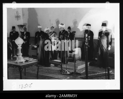 Coronation' of King Abdullah in Amman. Sheik handing King Abdullah proclamation of the crowning Abstract/medium: G. Eric and Edith Matson Photograph Collection  Physical description: 1 transparency:; 1946;  Catalog: https://www..gov/pictures/collection/matpc/item/mpc2005010234/PP Original url: https://hdl..gov/.pnp/matpc.14990; Matson Collection; - Stock Photo
