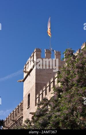 Detail of a tower of the Lonja de la Seda on which the flag of the Valencian community flies, Valencia, Spain. - Stock Photo