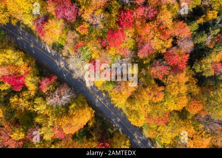 Aerial view of a road through White Mountain National forest, Lincoln, New Hampshire, USA - Stock Photo