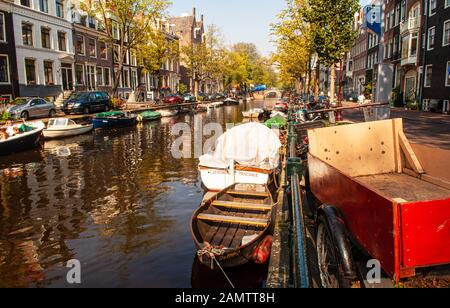 Amsterdam, Netherlands - October 2, 2011L Traditional Dutch houses like the Reguliersgracht canal in the centre of Amsterdam. - Stock Photo