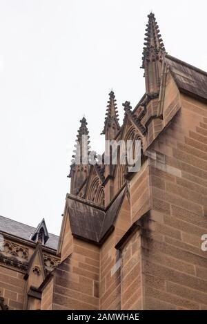 St Mary's Cathedral is built of Pyrmont sandstone in a Gothic Revival style with a bell tower located over the crossing of the nave and the transepts - Stock Photo