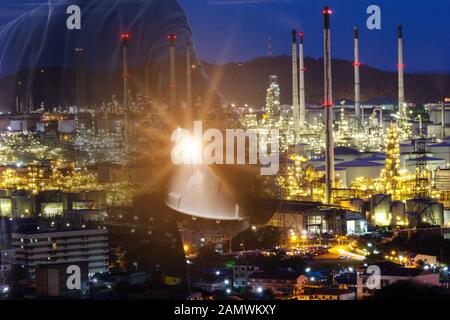 businessman Foreman working with night oil refinery industry plant and double exposure. Factory in the night as communication of energy. Smart technol - Stock Photo