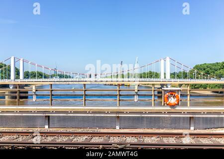 London, UK - June 27, 2018: Rail train from London Victoria Station railroad view from bridge on skyline and tracks - Stock Photo