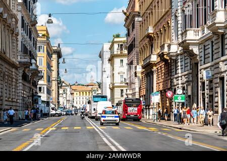 Rome, Italy - September 4, 2018: Italian street outside in historic city called Corso Vittorio Emanuele II with stores shops and bridge - Stock Photo