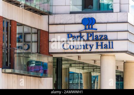 London, UK - June 22, 2018: Closeup of sign for park plaza County Hall hotel on exterior of building on street - Stock Photo