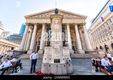 London, UK - June 26, 2018: Downtown financial district city and Royal Exchange entrance with many people wide angle view - Stock Photo