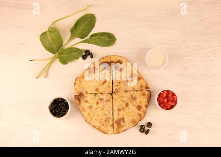 Healthy Stuffed Calzone Naan with Greens and Vegetables, Chicken Olives Herbs - Stock Photo