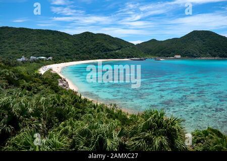 Aharen beach on Tokashiki island, Kerama archipelago, Okinawa, Japan, Asia. Japanese people swimming, tourists relaxing during vacation. Blue sea