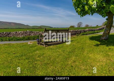 A bench with a view over the Yorkshire Dales near Hartlington, North Yorkshire, England, UK