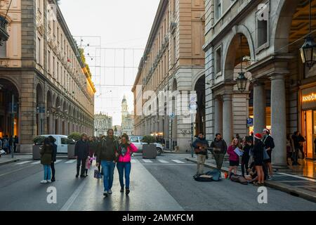 A group of scouts playing and singing in Via Roma street in the historic centre of Turin on Christmas Eve, Piedmont, Italy - Stock Photo