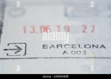 Close-up macro detail of European Union border control Spanish customs admission stamp with Barcelona word in focus - Stock Photo