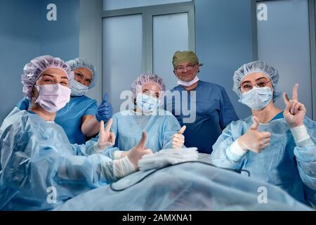 Collage of group of doctor, nurse, surgeon people over isolated background smiling looking to the camera showing success or thumbs up sign. - Stock Photo