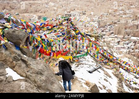 JAMMU KASHMIR, INDIA - MARCH 20 : Traveler thai women tied prayer and blessing flags on mount of Thiksey monastery and Namgyal Tsemo Gompa in Leh lada