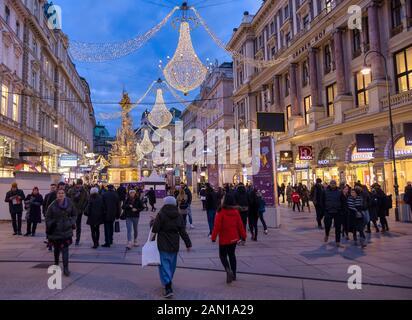 VIENNA, AUSTRIA - DECEMBER 30: Tourists walk around the Plague Column (in German: Pestsäule) at the Graben street on December 30, 2019 in Vienna, Austria. - Stock Photo