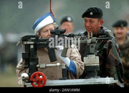 HM Queen Elizabeth II fires a rifle at the army rifle association, Bisley, England July 1993 - Stock Photo