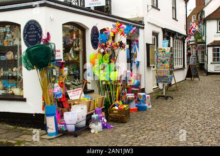 8 June 2017 A colourful display of novelty goods for sale outside a shop in Lymington on the South coast of England, - Stock Photo