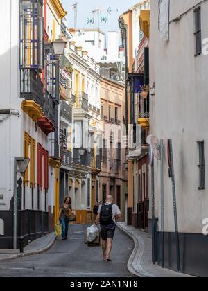 Colourful buildings line the narrow Calle Santiago in Santa Cruz, Seville