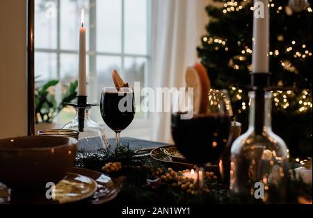 traditional Swedish drink mulled wine, glogg on a table at Christmas - Stock Photo