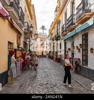 Colourful buildings line the narrow Pasaje de Andreu in Seville's old Jewish Quarter in Santa Cruz