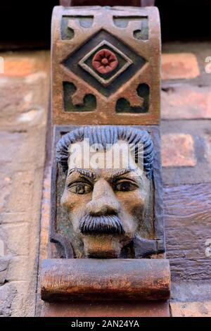 Carved face on wooden beams from Hans Raffns house from the Middle Ages, angel house in Ystad, Scania, Sweden - Stock Photo