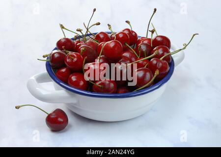 Sweet cherries in bowl, Germany - Stock Photo