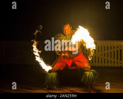 Local fire dancer in the Matavai Resort, Niue - Stock Photo