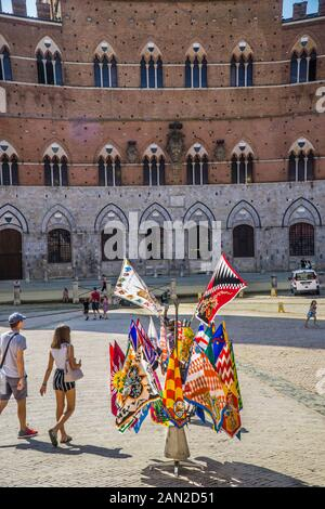 Banners of the city's contrade (districts) on Siena's Piazza del Campo, Siena, Tuscany, Italy